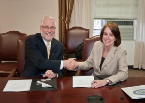 Dave White, NRCS, Chief signing MOU  with the Army Corps of Engineers